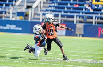 ... Palm Beach County Youth Football League s 105Pound Division All-Stars  during action against Key West in the annual Orange Bowl Youth Football  Alliance. 99a6244f9
