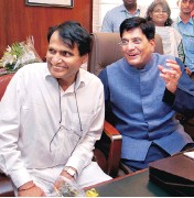 ?? PHOTO: DALIP KUMAR ?? Piyush Goyal ( right), who assumed charge of the Ministry of Railways, with Suresh Prabhu, the erstwhile railway minister who is now the commerce and industry minister, at Rail Bhavan in New Delhi on Monday