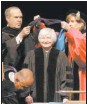 ?? PATRICK SEMANSKY / ASSOCIATED PRESS ?? Federal Reserve Board Chair Janet Yellen, center, is hooded for an honorary doctor of laws degree before speaking at the University of Baltimore's fall commencement in Baltimore on Monday.