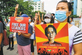 ?? Associated Press ?? Coup protesters march in Yangon to demonstrate against the military junta that seized power on Feb. 1. More than 700 protesters have been killed during daily protests across Myanmar.
