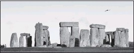 ?? THE ASSOCIATED PRESS ?? Visitors photographed the World Heritage Site of Stonehenge, England, in December 2013. On Nov. 12, the British government went against the advice of planning officials when it approved plans for a road tunnel to be built near the prehistoric monument.
