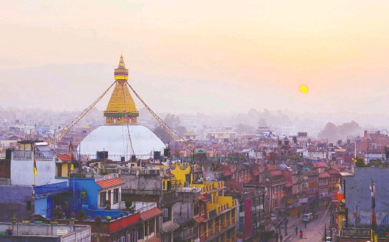 ?? GETTY IMAGES ?? The sun rises over Kathmandu, unveiling the promise of a new day of unforgettable experiences that are both overwhelming and invigorating.