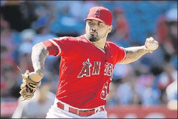 ?? Jae C. Hong Associated Press ?? ANGELS STARTER Hector Santiago pitches against the Red Sox during Game 1 of a doubleheader.