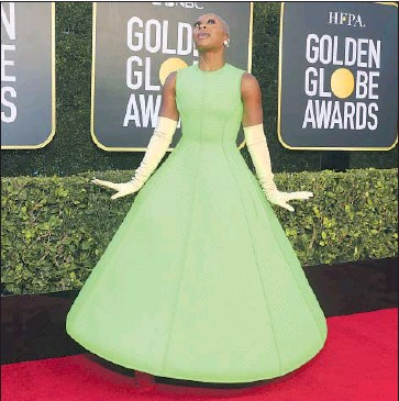 ?? Todd Williamson NBC / NBCU Photo Bank via Getty Images ?? CYNTHIA ERIVO rules the red carpet at the Beverly Hilton on Sunday in her structured Valentino gown.