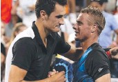 ?? Picture: AFP ?? SO LONG: An epic five-set battle with fellow Aussie Bernard Tomic (left) ended Lleyton Hewitt's run at the US Open yesterday.