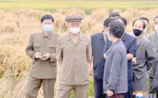 ?? — Reuters ?? North Korea's Premier Kim Tok Hun inspects the agricultural and light industrial fields in South Phyongan.