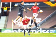 ??  ?? Manchester United's Brazilian defender Alex Telles (C) looks on as Granada's Brazilian midfielder Kenedy (L) vies with Manchester United's French midfielder Paul Pogba (R) during the football match at Old Trafford stadium in Manchester. - AFP photo
