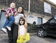 ?? J. Patric Schneider ?? Rosa Rosario and her children — Jessica, 4, and Carlos, 2 — live in an apartment in Gulfton, an area that serves as a gateway to immigrants in Houston.