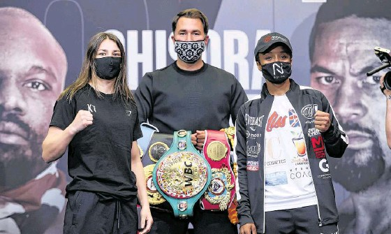 ?? PHOTOGRAPH: INPHO ?? World champion Katie ■ Taylor with promoter Eddie Hearn and tonight's opponent Natasha Jonas from Liverpool at a press conference yesterday.