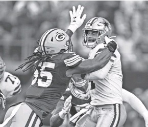?? GETTY IMAGES ?? Za'Darius Smith, in the face of the Cowboys' Dak Prescott on Sunday, is second on the Packers with five quarterback takedowns.