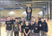 ?? Special - Chris Butler ?? The Guerilla Wrestling Academy 14U team hoists the championship trophy after winning the state traditional meet championship last Saturday at the Lakepoint Sports Complex.