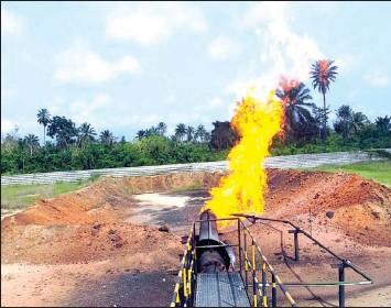 ??  ?? Ground- based gas flaring