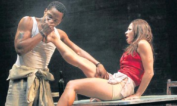 ?? Picture: RUPHIN COUDYZER ?? ELECTRICAL CHARGE: Bongile Mantsai as John and Hilda Cronje as Julie in Mies Julie'