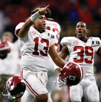?? JAMIE SQUIRE/GETTY IMAGES ?? Alabama Crimson Tide quarterback Tua Tagovailoa celebrates beating the Georgia Bulldogs 26-23 in overtime to win the College Football Playoff national championship at Mercedes-Benz Stadium in Atlanta on Monday.