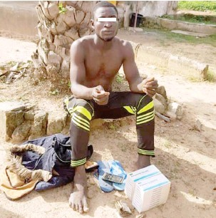 ?? Photo: DHQ ?? A suspected drug peddler during his arrest by troops of Forward Operation Base with alleged 20 packets of Pentazocine injection concealed in his motorcycle at Kungurmi village of Bungudu L.G.A in Zamfara State. The military accused him of supplying hard drugs to bandits