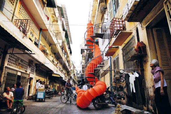 ??  ?? snaking saffron Spiral Alley, a work from Anida Ali's performance series The Buddhist Bug Project, won the Sovereign Asian Art Prize this year
