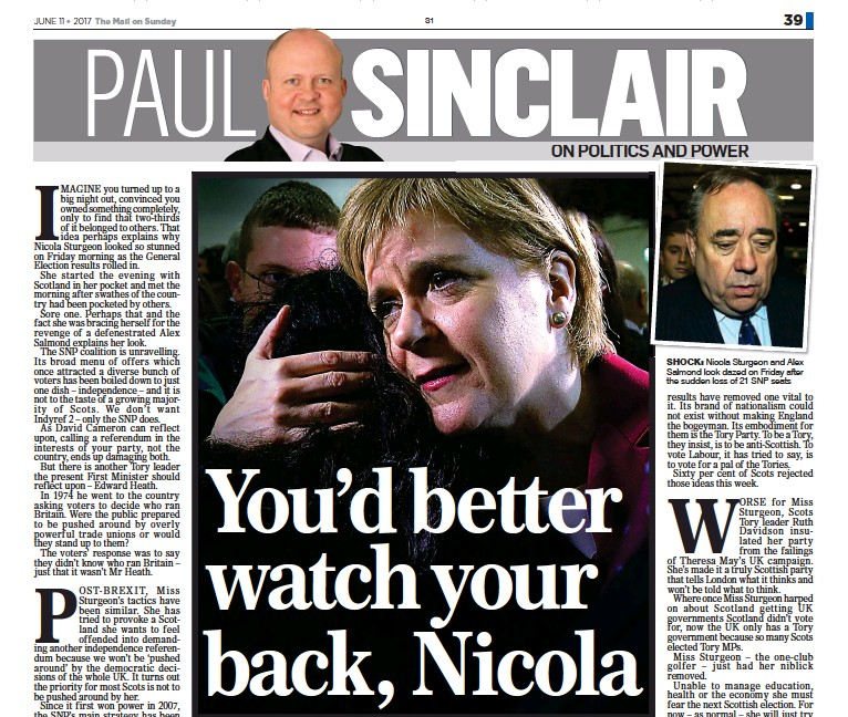 ??  ?? SHOCK: Ni­cola Stur­geon and Alex Sal­mond look dazed on Fri­day af­ter the sud­den loss of 21 SNP seats