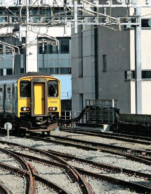?? PAUL BIGLAND/ RAIL. ?? TfW Rail 175002 passes 150282 on the ap­proach to Cardiff Cen­tral on Septem­ber 12. Welsh Gov­ern­ment is seek­ing par­ity with Scot­land where min­is­ters have de­volved con­trol over in­vest­ment in the rail net­work.