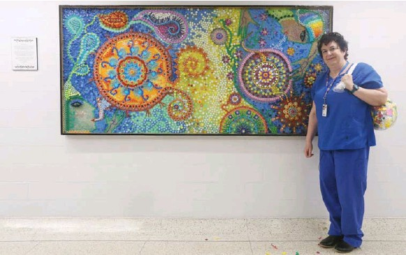 ?? STEVE RUSSELL PHOTOS/TORONTO STAR ?? Nurse Tilda Shalof collected medicine caps and lids, IV tubes and syringe covers. With the help of artist Vanessa Herman, she turned them into a massive mural, using 10,000 pieces.