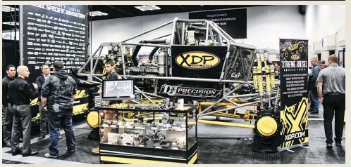 ??  ?? PXDP hauled its Cum­mins-pow­ered mon­ster truck to PRI in bod­i­less form to give show-go­ers an in­sider's view of what goes into their state-of-the-art ma­chine. From the Patrick En­ter­prises chas­sis to the D&J En­forcer se­ries com­pound tur­bocharged Cum­mins, and the air-shifted Lenco to the Pet­ti­bone and Rock­well axles, there was plenty to gawk at. As a bonus, driver Dave Radzierez was also hang­ing out in the booth.