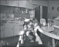 """?? DR. MARK NOWACZYNSKI PHOTO ?? Clarence, 91, seen in his sun-dappled kitchen, is frail but refuses a walker. """"I creep around,"""" says the former oil company executive."""