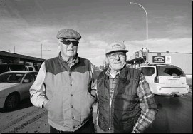 ??  ?? Orvill Johnson, left, walks the main drag of Sundre with Cal Price. Both say that despite recent frustrations, they'll stick with the Tories.