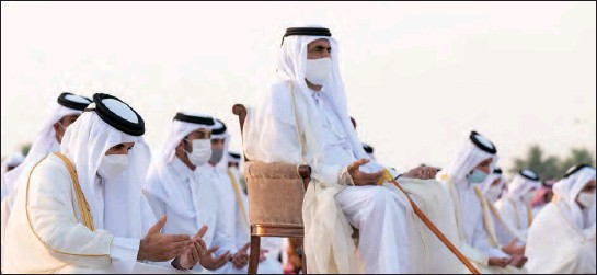 ??  ?? His Highness the Amir of State of Qatar Sheikh Tamim bin Hamad Al Thani and Father Amir performed Eid Al Fitr prayer along with citizens at the Al Wajba praying area on Thursday.