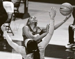 ?? Thomas Graning / Associated Press ?? Texas A&M guard Kayla Wells tallied 18 points and nine rebounds in a 66-55 win over Mississippi on Sunday afternoon in Oxford, Miss.