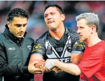 ?? Photo / Photosport ?? Kiwis winger Jordan Rapana is treated for a dislocated shoulder in Monday's test.