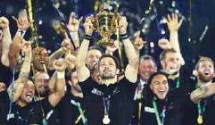 ??  ?? Captain Richie McCaw of New Zealand holds up the Webb Ellis Cup after winning the Rugby World Cup final against Australia at Twickenham in London yesterday. New Zealand won by 34-17. –