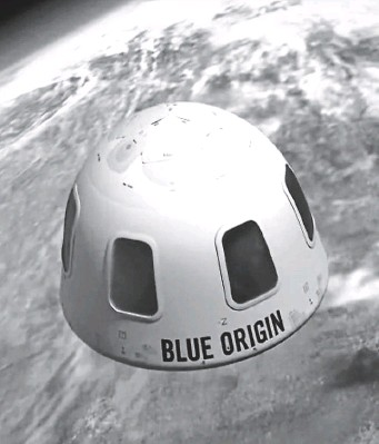 ?? AP FILE PHOTOS ?? LOT OF DOUGH: This illustration provided by Blue Origin shows the capsule that the company aims to use to take tourists into space. The price to rocket into space next month with Jeff Bezos, left, and his brother is a cool $28 million. That was the winning bid during the live online auction on Saturday.