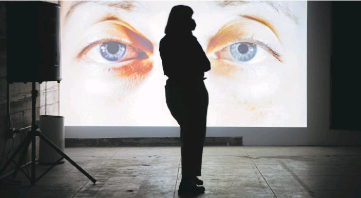 """?? Santiago Mejia / The Chronicle ?? Agnes Palotas looks at """"Human/ID"""" by StratoFyzika at CounterPulse in S.F. The art installation allowed pods of up to four people at a time to view installations."""