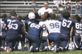 ?? Associated Press file photo ?? Coach Randy Edsall talks with his team at the end of UConn's annual Spring game in April.