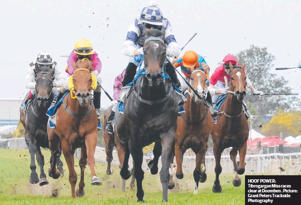 ??  ?? HOOF POWER: Ti­brog­a­r­gan Miss races clear at Doomben . Pic­ture: Grant Peters Track­side Pho­tog­ra­phy