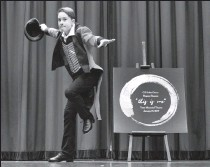 """?? Herald photo by Ian Martens ?? Grade 7 student Tristan Bissett, in character as showman P.T. Barnum, slides across the floor as the G.S. Lakie Dance Program gets set to stage its production of """"This is Me"""" Wednesday at the Yates Theatre. @IMartensHerald"""