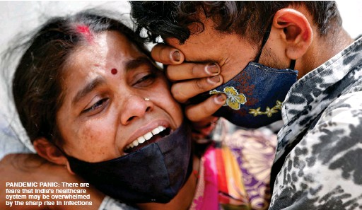 ??  ?? PANDEMIC PANIC: There are FEArs tHAt INDIA's HEALtHCArE systEM MAy BE OvErwHELMED By tHE sHArP rIsE IN INFECtIONs