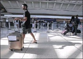 ?? Irfan Khan Los Angeles Times ?? PASSENGERS WALK through the Ontario terminal. Los Angeles was required to pursue regionalization of airports under a 2006 court settlement.