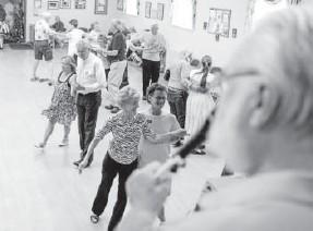 ??  ?? Bear Miller calls a dance at the Maple Grove Grange in Denver on July 14.