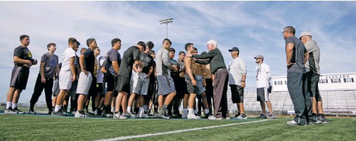 ?? MATT DAHLSEID/THE NEW MEXICAN ?? Capital High football players and coaches meet at the center of the field to end practice Wednesday.