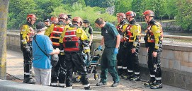 ?? Picture: Stewart Cowper. ?? The scene following the dramatic rescue in Perth yesterday morning.