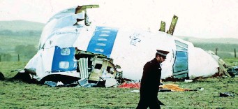 ?? AP African News Agency (ANA) ?? A POLICE officer walks by the nose of Pan Am flight 103 in a field near the town of Lockerbie, Scotland where it lay after a bomb aboard exploded, killing a total of 270 people, in this December 21, 1988 file photo. |