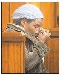 ??  ?? HORROR RECALLED: Domestic worker Rachel Tsitsi breaks down in tears in court yesterday. She was the first person to arrive on the murder scene