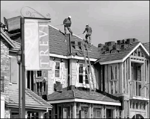 ?? By Justin Sullivan, Getty Images ?? Under construction: Workers move roofing tiles onto the roof of a home in Dublin, Calif., last month. Sales of new homes are suffering as foreclosures drive down prices.