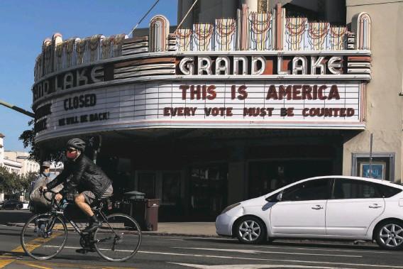 ?? Santiago Mejia / The Chronicle ?? Oakland's Grand Lake Theatre marquee features a message embraced by the Democratic ticket and is proving apt as the counting goes on in contested states.