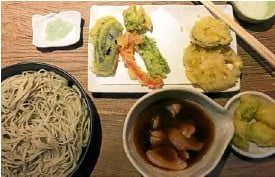 """??  ?? Cold soba with hot duck soup served with duck meat, mountain yam and green onion tempura; Soba master Rai using the soba """"kiri"""" to cut the dough (left)"""