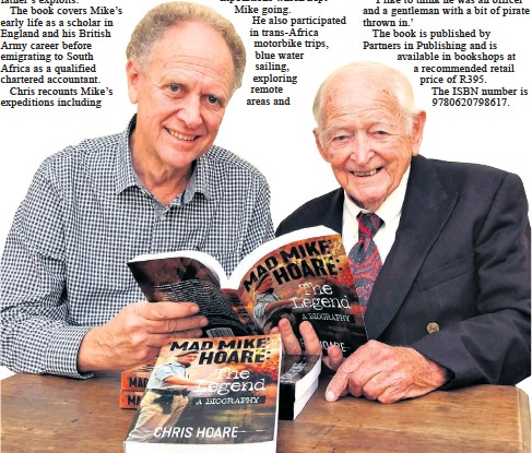 ??  ?? Author Chris Hoare shows his father, the famous 'Mad Mike' Hoare, now aged 99 and living in Durban, a copy of his biography on Mike