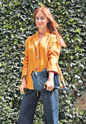 ??  ?? • Orange jacket from Rejina Pyo, as are the jeans; bag is APC