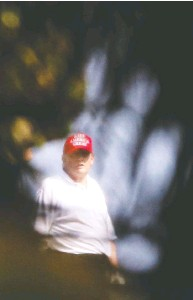 ?? MARCO BELLO/REUTERS ?? Former U.S. president Donald Trump looks on at the Trump International Golf Club in Florida on Monday.