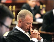??  ?? Memorable images of Nel show him deep in thought, left, and in a more upbeat pose addressing the Supreme Court of Appeal in Bloemfontein.