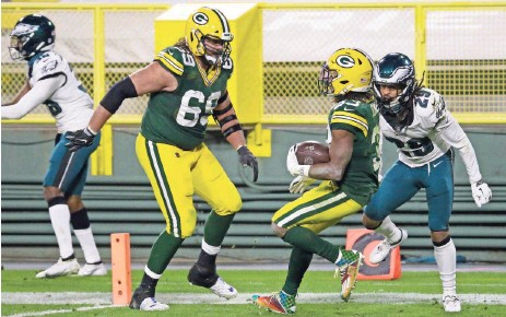 ?? ASSOCIATED PRESS ?? Packers running back Aaron Jones clinched victory for Green Bay with an electrifying 77-yard touchdown run against the Philadelphia Eagles in December.